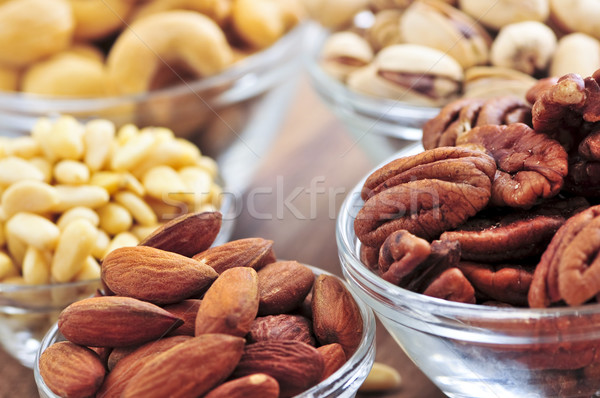 Bowls of assorted nuts Stock photo © elenaphoto