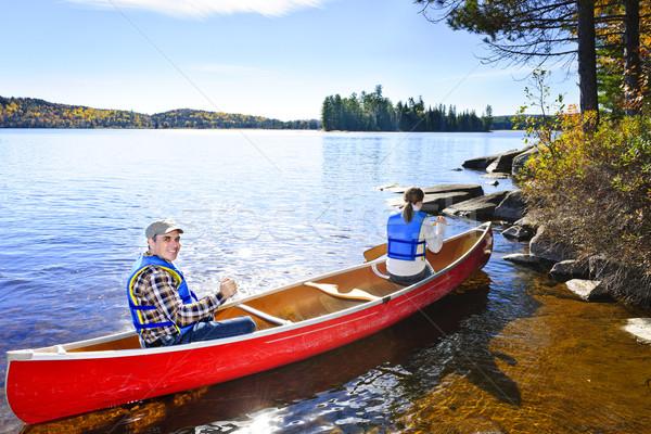 Canoeing near lake shore Stock photo © elenaphoto