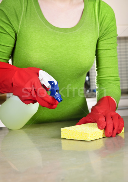 Girl cleaning kitchen Stock photo © elenaphoto