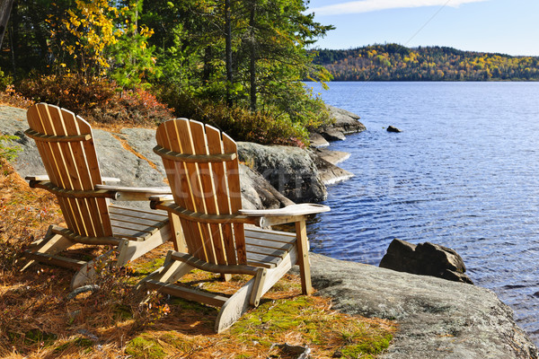 Stock photo: Adirondack chairs at lake shore