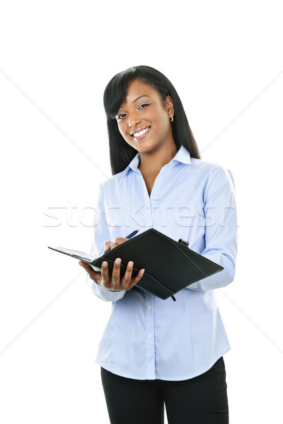 Smiling woman with leather portfolio folder Stock photo © elenaphoto