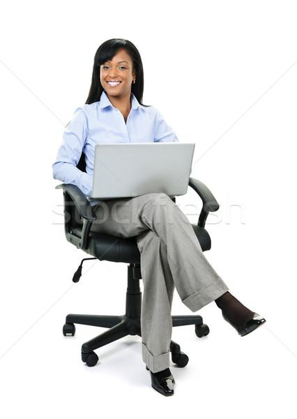 女性実業家 座って 事務椅子 コンピュータ 小さな 笑みを浮かべて ストックフォト © elenaphoto