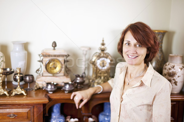 Woman with antique collection Stock photo © elenaphoto