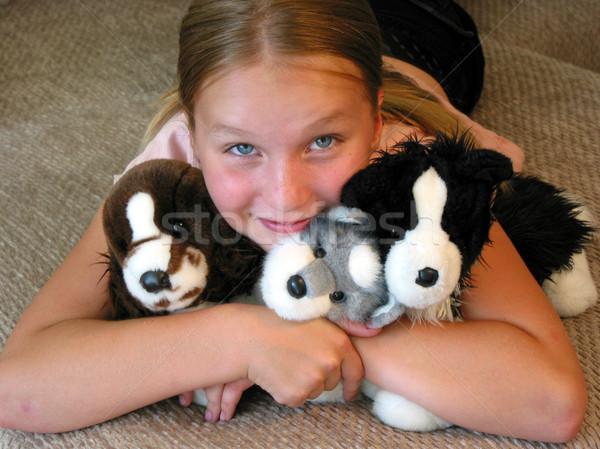Girl hugging her plush toys Stock photo © elenaphoto