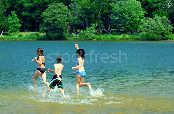 Children in a lake Stock photo © elenaphoto