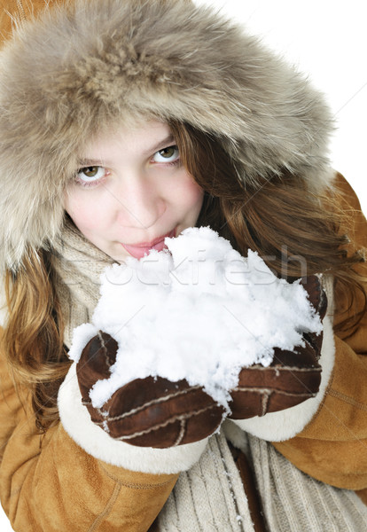 Playful winter girl holding snow Stock photo © elenaphoto