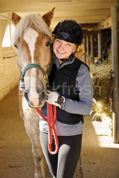 Rider with horse in stable Stock photo © elenaphoto