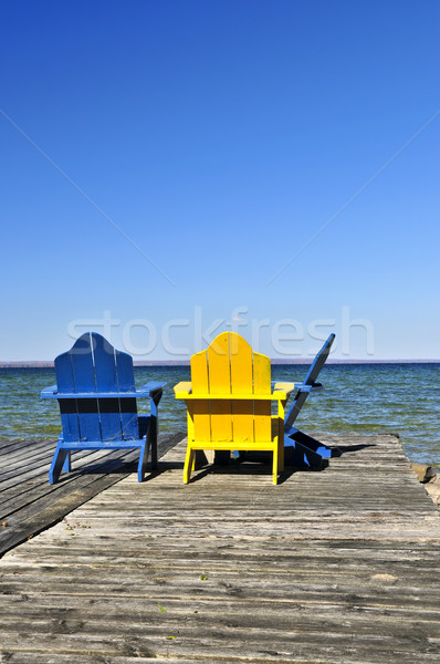 Stock photo: Chairs on wooden dock at lake
