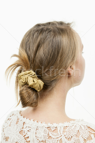 Young woman with casual messy bun hairdo Stock photo © elenaphoto