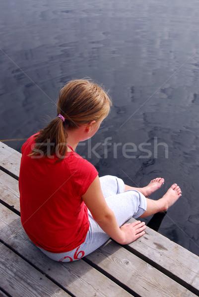 Criança doca jovem sessão borda barco Foto stock © elenaphoto