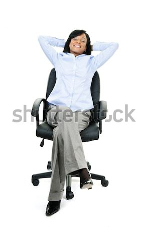 Businesswoman on phone sitting in office chair Stock photo © elenaphoto