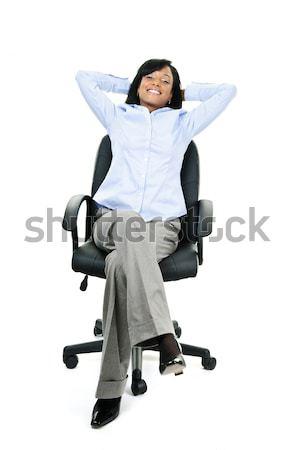 女性実業家 電話 座って 事務椅子 小さな 笑みを浮かべて ストックフォト © elenaphoto