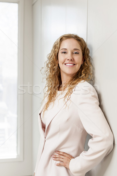 Successful businesswoman standing in hallway Stock photo © elenaphoto