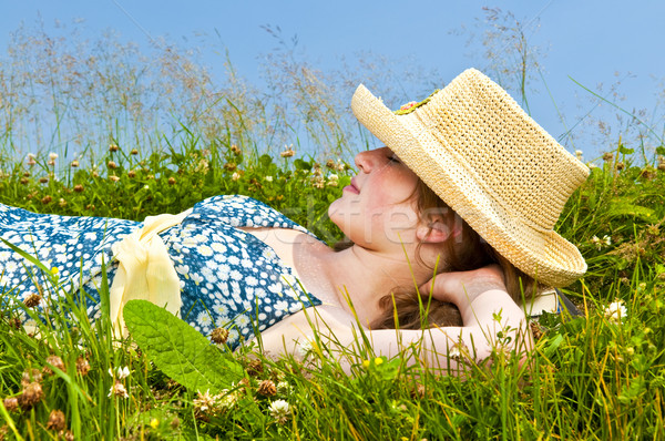 Young girl resting in meadow Stock photo © elenaphoto