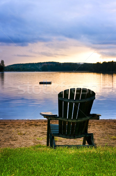 Wooden chair at sunset on beach Stock photo © elenaphoto