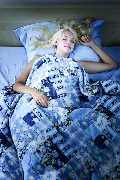 Woman sleeping in bed at night Stock photo © elenaphoto