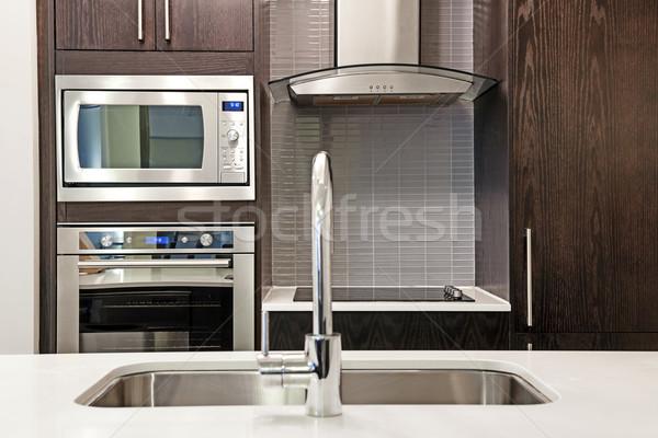 современных интерьер кухни роскошь каменные нержавеющая сталь Сток-фото © elenaphoto