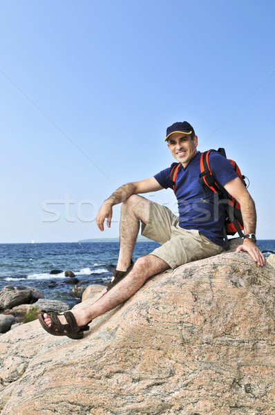Hiker sitting on a rock Stock photo © elenaphoto