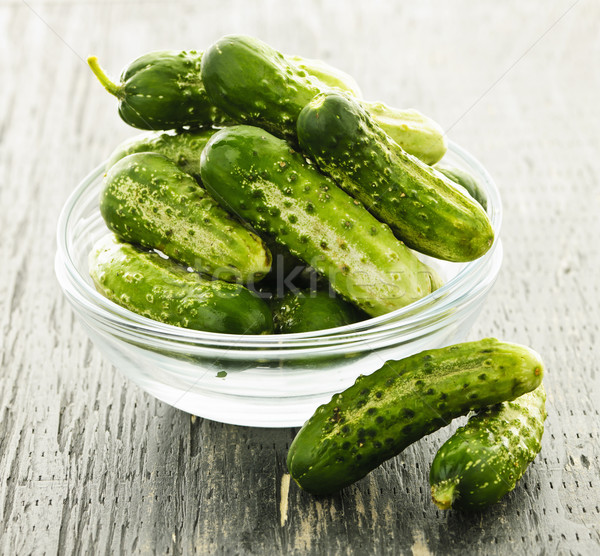 Small cucumbers in bowl Stock photo © elenaphoto