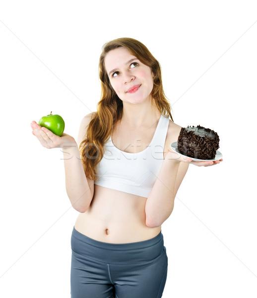 Young girl holding apple and cake Stock photo © elenaphoto