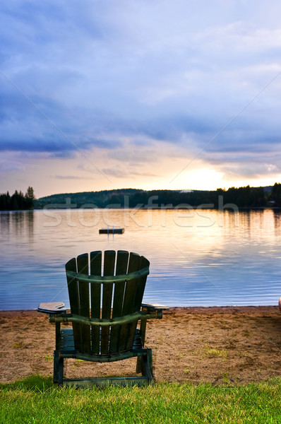 Wooden chair at sunset on beach Stock photo © elenaphoto