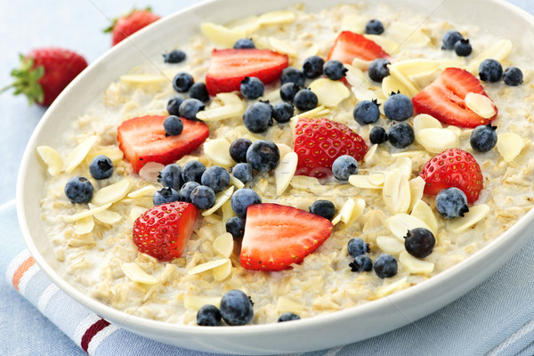 Oatmeal breakfast cereal with berries Stock photo © elenaphoto