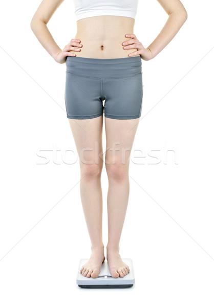 женщину Постоянный весы здорового изолированный Сток-фото © elenaphoto