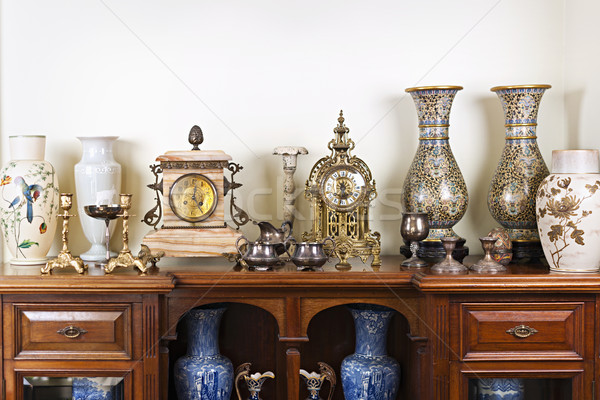 Stock photo: Antique vases and clocks