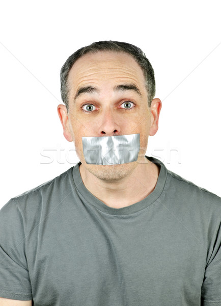 Man with duct tape on mouth Stock photo © elenaphoto