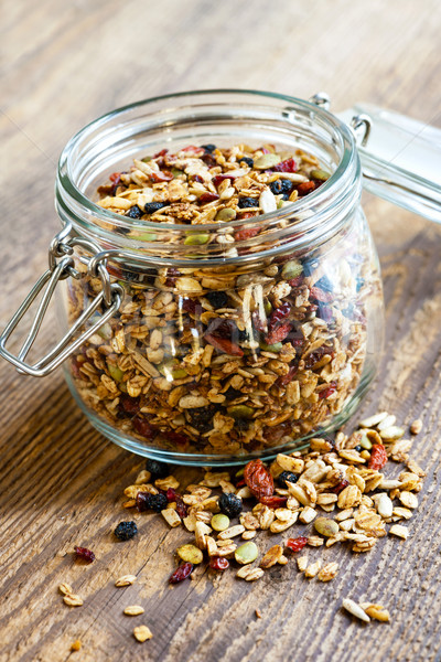 Homemade granola in open glass jar Stock photo © elenaphoto