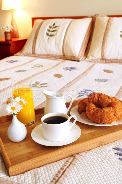 Breakfast on a bed in a hotel room Stock photo © elenaphoto
