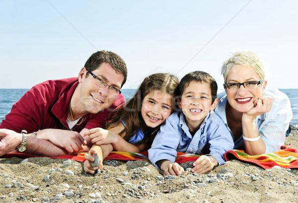 Happy family at beach Stock photo © elenaphoto