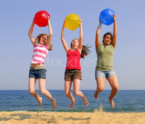 Girls on a beach Stock photo © elenaphoto