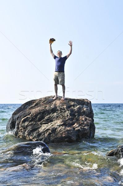 Man stranded on a rock in ocean Stock photo © elenaphoto