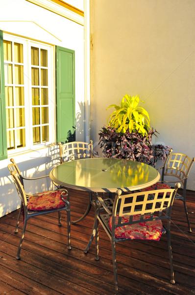 Patio chaises bois pont mur Photo stock © elenaphoto
