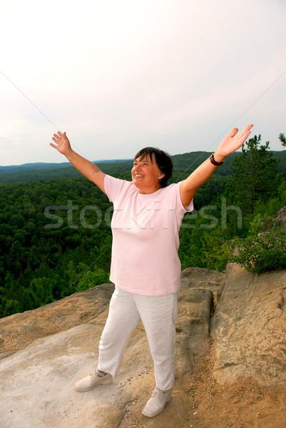 Mature woman cliff Stock photo © elenaphoto