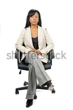 Black businesswoman sitting in office chair Stock photo © elenaphoto