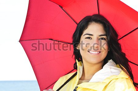 Smiling young woman relaxing looking up Stock photo © elenaphoto