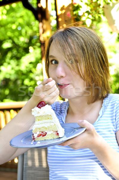 Girl eating a cake Stock photo © elenaphoto