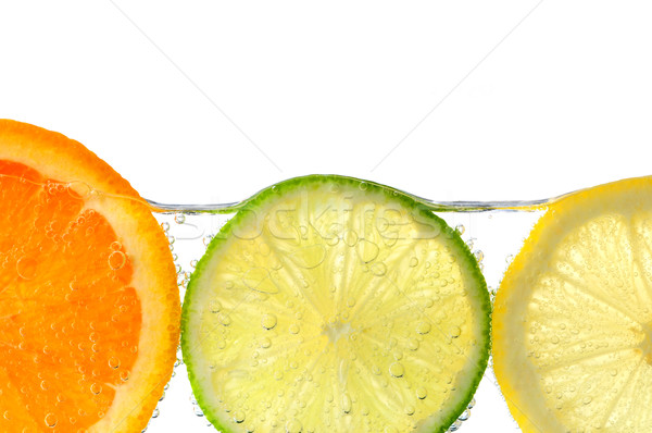 Orange lemon and lime slices in water Stock photo © elenaphoto