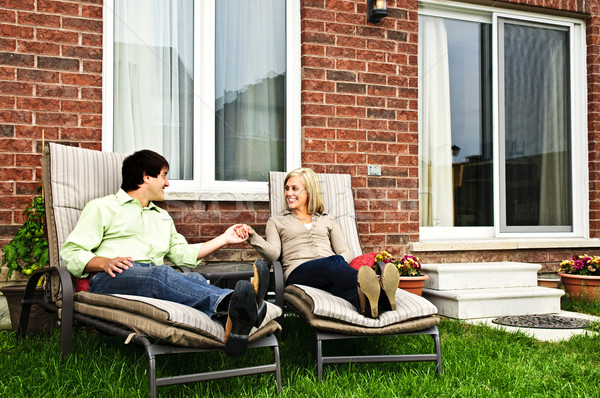Stock photo: Happy couple relaxing at home