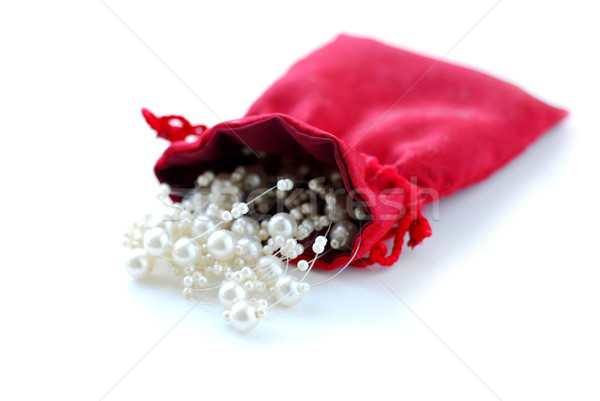 Pearls in red pouch Stock photo © elenaphoto