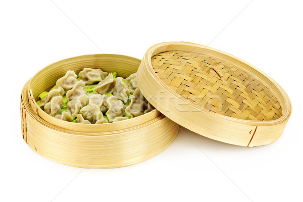 Bamboo steamer with dumplings Stock photo © elenaphoto