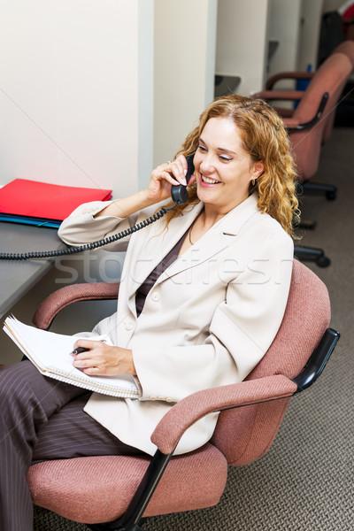 Gülümseyen kadın telefon mutlu işkadını telefon Stok fotoğraf © elenaphoto