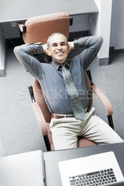Adam oturma işadamı dizüstü bilgisayar ofis Stok fotoğraf © elenaphoto
