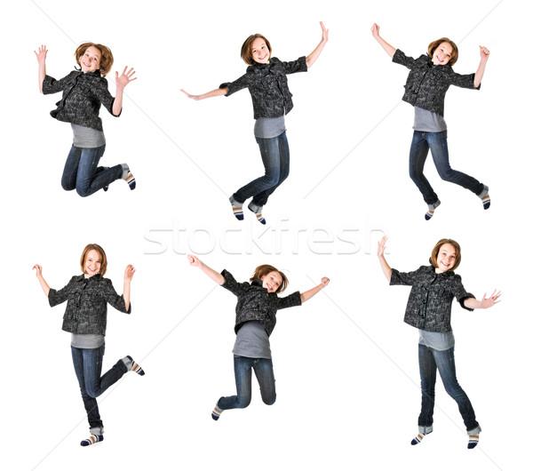 Teenage girl jumping on white background Stock photo © elenaphoto