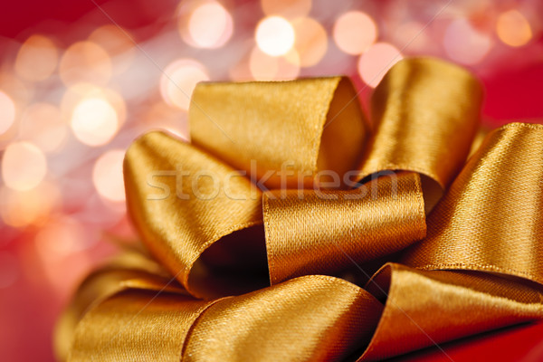 Gold gift bow with festive lights Stock photo © elenaphoto