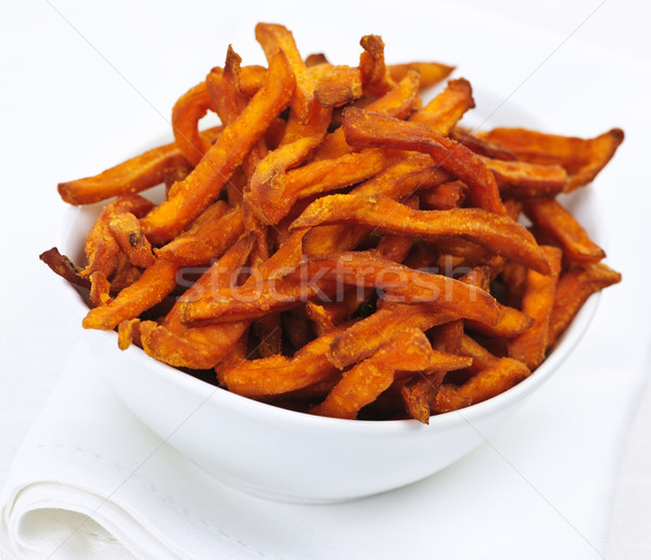Zoete aardappel frietjes witte kom achtergrond Stockfoto © elenaphoto