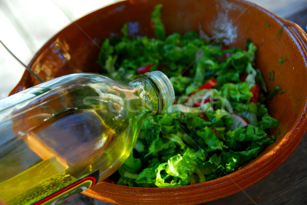 Garden salad and olive oil Stock photo © elenaphoto