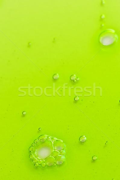 Soyut yeşil sıvı jel kabarcıklar boya Stok fotoğraf © elenaphoto